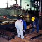 Shearing the Old Way – Without a conveyor operators are required to manually sort trims and pieces on the floor (click for larger view)