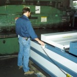 "Sheets are fed into the shear with +/-0.005"" tolerance (click for larger view)"