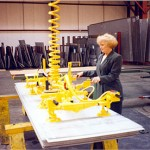Sheets move easily with double articulated jib to shear table (click for larger view)